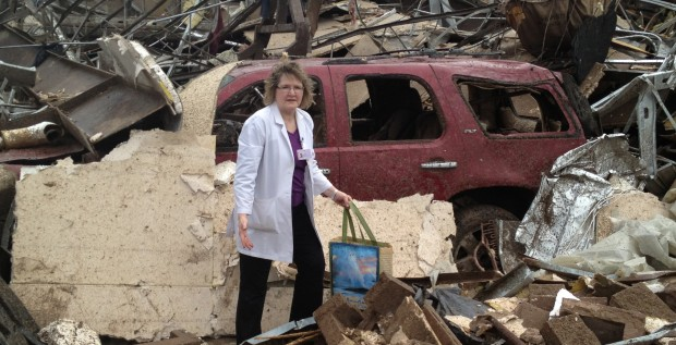 Barbara Poe attempts to retrieve possessions from her GMC Yukon about two hours after an EF5 tornado tore through Moore, OK, on May 20.  The tornado destroyed Moore Medical Center, where Poe is lead pharmacist. Photo courtesy of Darin Smith.