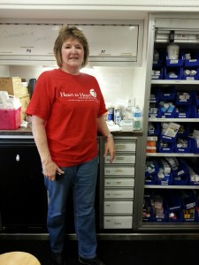 Barbara Poe takes a break in the medication area of the Heart to Heart International's mobile medication unit. Photo courtesy of Nina Morris.