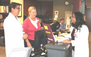From left, Eugene Varoz, clinical pharmacist, consults with Peggy Reap, R.N., and Madhur ??, M.D.