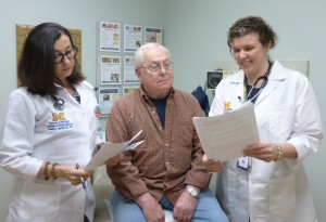 Pamela G. Rockwell, D.O. (left) and Heidi Diez, Pharm.D., (right) counsel a patient about his medication regimen.