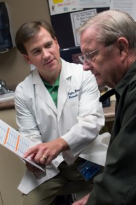 From left, James L. Taylor, Pharm.D., talks to a patient about his medication regimen.